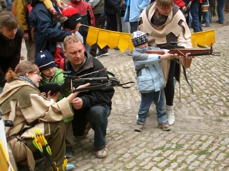 ...kids looking confidently comfortable with a crossbow nestled into their sweaty palms...