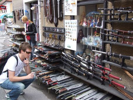 Brett carefully selecting his weapons at the local tourist market.