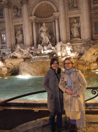 Maria and Sarah posing in front of the fountain.