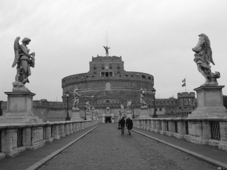 Castel Sant'Angelo from the bridge. The angel statue on the top depicts the angel from whom the building derives its name.