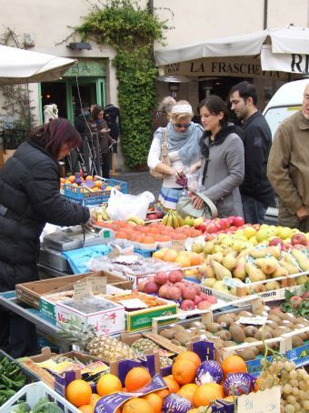 Campo de' Fiori. Sarah and Maria bargaining on the fruit and veg.