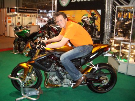 ... actually, I like this Benelli GP racer better (was made to fit me). After looking at this beautiful gem for 6 days I couldn't resist throwing a leg over after closing time one night - the best time to see a bike show!