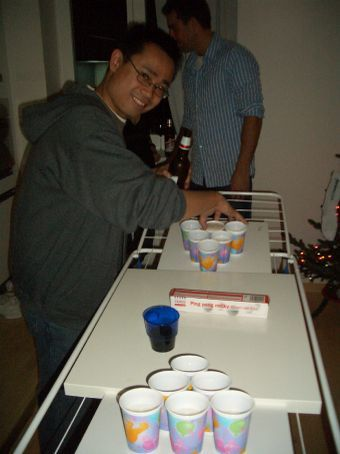 Jason prepares the beer-wine ping-pong/bowling table...