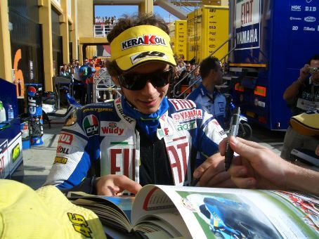 Valentino Rossi signing the book for charity. You just double the proceeds in one foul swoop of the pen!