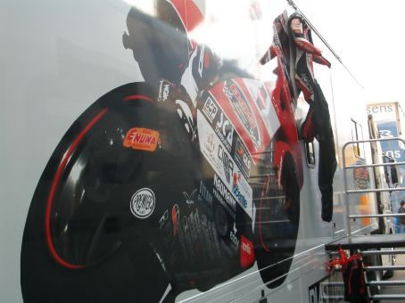 Inside the paddock - leathers hanging up on the truck.