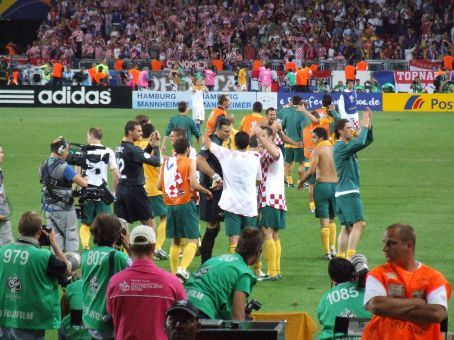 More euphoria - some players have swapped jerseys with Croatian counterparts. Note Viduka congratulating Aloisi, in turn contratulating Kalac (the goalkeeper). Note Lucas Neill in the background who went nuts.