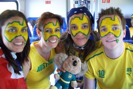 Helen, Maria, Bernie and Brett with faces painted on the train on the way to Kaiserslautern. Funny how the World Cup gives people licence to look like total freaks. You may have seen the two freaks in the middle on Ch 9 news!