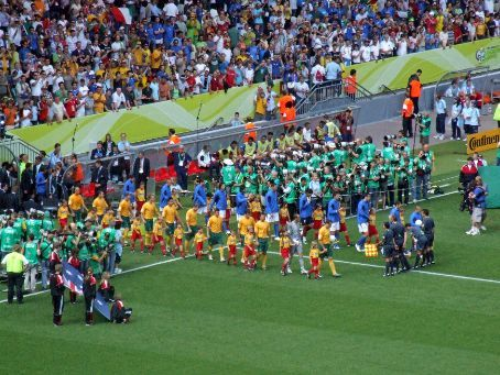 The Socceroos come out onto the pitch, to the raucous cheers of the Aussie fans and, possibly, 95% of the stadium - and millions more at home in Aus!