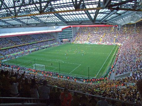 View of the stadium at Kaiserslautern. This stadium is perched atop the summit of a hill, with entrances beginning some several hundred metres at the bottom of the hill on all sides.