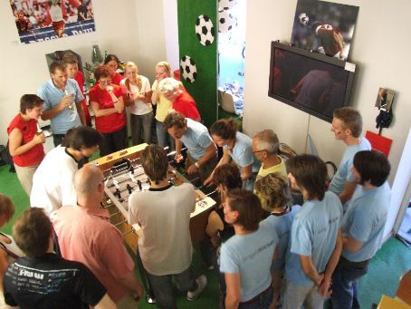 'Kicker' comnpetition for charity (table soccer, or 'Foosball') in Munich. It was hosted by a football-mad optometrist who turned his shop into a smoke-filled bar for the round robin evening. Our new friend, Franzi, was playing in the blue team, but unfortunately couldn't knock out the ever so serious competition.
