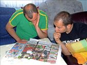 Robert (Dijana's brother) and Mig studying the football form before the France v Brazil semi-final.: by maria_brett, Views[418]