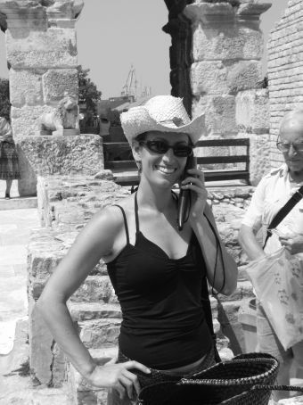 Maria getting the latest football results on her mobile, from the colosseum in Pula.