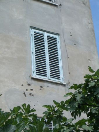 Evidence of the war still remains in Zadar in some places. You have to wonder what happened to the person who must've been standing or peering from this window to attrack the attention of enemy fire.