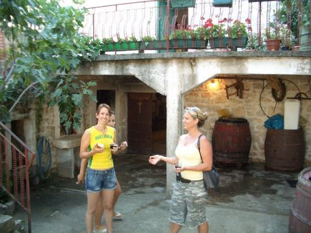 Walking past Maria's grandfather's brother's house in Policnik, we were invited - actually dragged inside for a drink of homemade wine. Maria loved the figs that were just ripening on the trees.