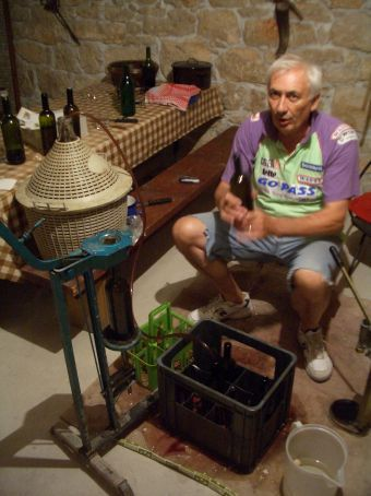 Maria's grandfather's brother bottling his wine in his cellar.