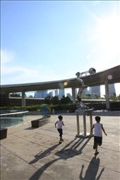 Pursuit of happiness. Two brothers play a simple game, chasing each other, the first person who passes the artwork will win. Beneath the bright blue sky, a perfect day to play.   : by marinabarragesingapore, Views[163]