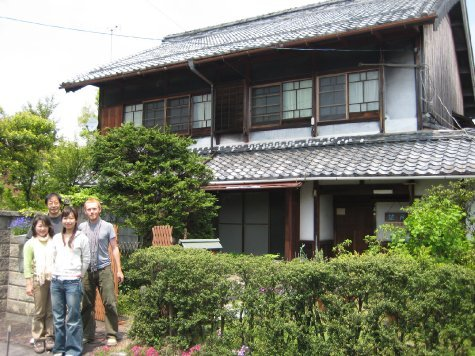 Me with Pete and Kumi's parents outside their house in Shigu