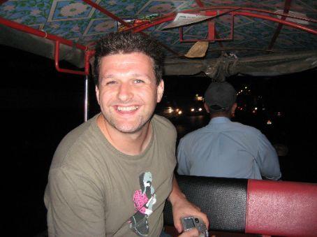 Simon rides on a tuk-tuk through the evening traffic in Phnom Penh