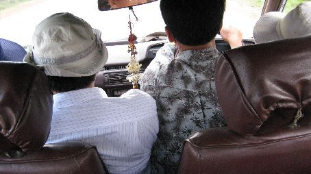 Four Cambodians in the front seat of a taxi....brilliant!