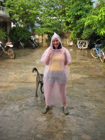 Maria glams up in a pink ponch while a dog lurks