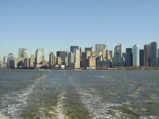 On the boat out to Liberty Island with the New York skyline behind.