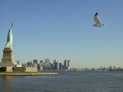 The Statue of Liberty and New York behind it.
