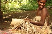This young woman, living in a remote Kastom village in Tanna, where people still live according to millenary traditional customs, is weaving a basket with pandanus leaves. Lekalangia, Tanna, Vanuatu.: by marysusan, Views[840]
