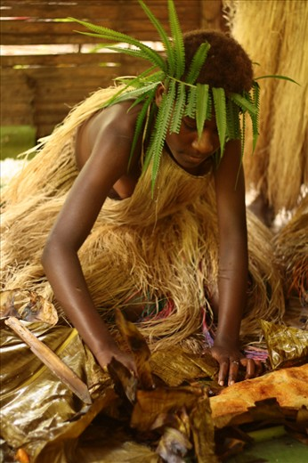 Woman preparing the laplap, the typical dish of the country, made with cassava, banana and coconut. Other foods can be added, like meat or fish according to the regions. Lekalangia, Tanna, Vanuatu.
