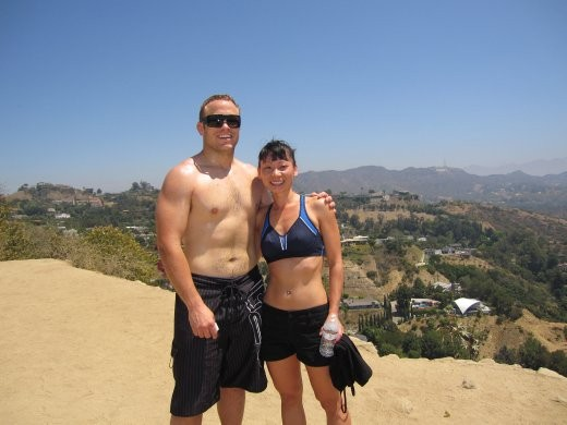 Hiking through Runyon Canyon trails. Less than impressive Hollywood sign right of Tani's shoulder