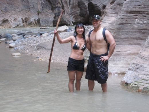 Amazonian woman with stick alongside white man, nearing completion of down river leg...