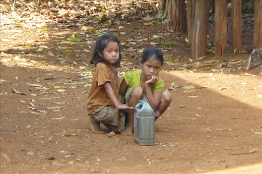 Some young girls collecting water - in oil cans!!