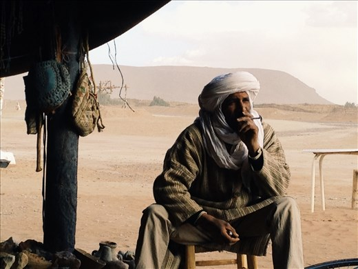 Enjoying shelter and tea during in a bedouins hut during a sandstorm