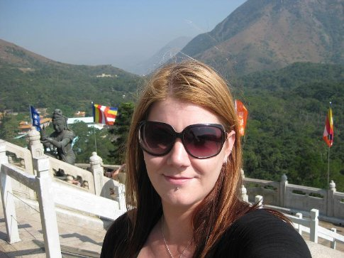 At the Po Lin Monastery on Lantau Island, standing right near the big Buddha statue. It was so amazingly beautiful up there. :)