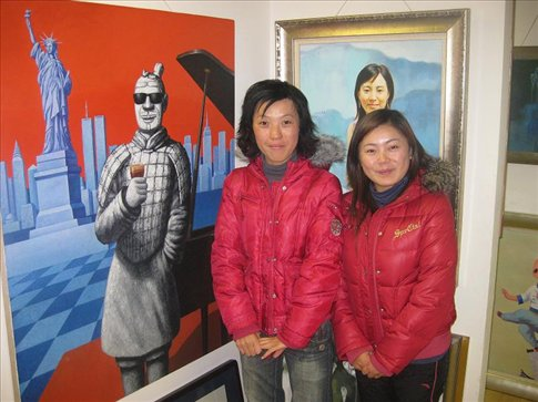 Two art students that I met while walking around The Bund. They took me to their art gallery and showed me around.  I love the painting in the back ground of the terracotta warrior on holiday in New York. hehe.