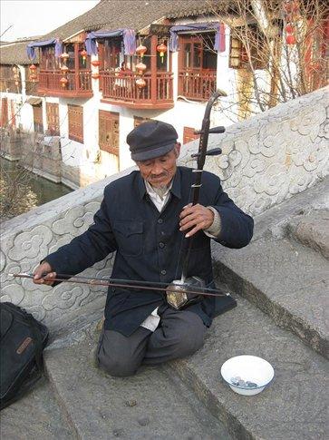 A busker playing a erhu on a bridge in Zhujiajiao. He was VERY good.