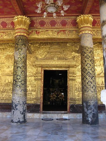 The magnificent entrance to the Wat Xieng Thong temple on the main street of Luang Prabang.