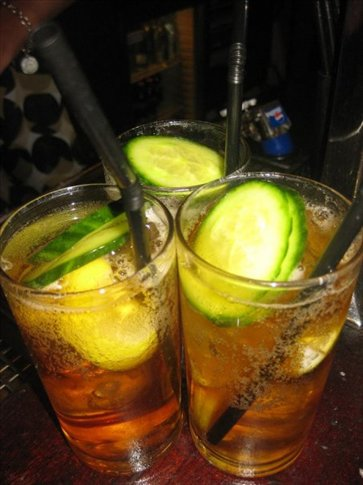Pimms with cucumber, lemon and lime.