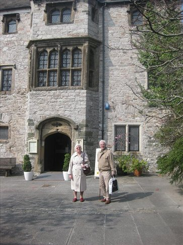 My Granny and Grandad standing in front of the oldest house in Plymouth. :)