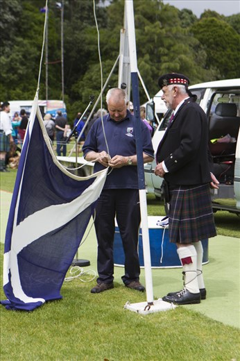 The Scottish Flag is prepared under the watchful eye of the Master of Ceremonies