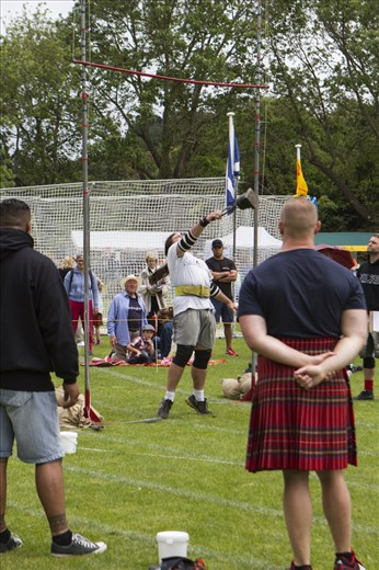 Traditional Scottish strong man events - hurling weights over the high bar