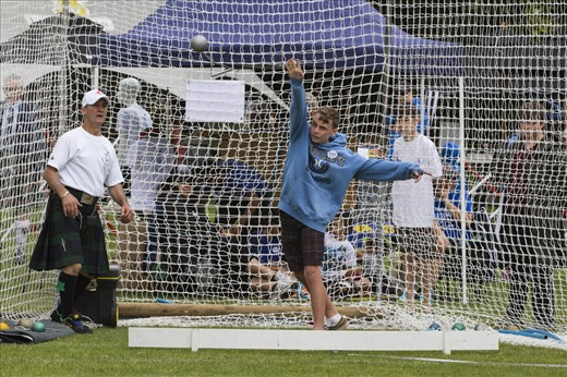 Junior Highland Games competitors try out traditional weight throwing
