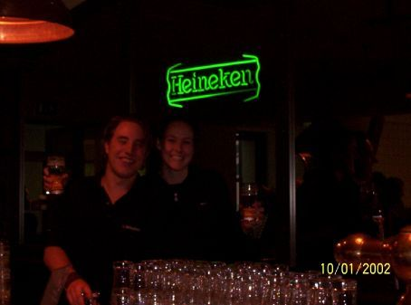 Jas and the barman at the Heineken factory, Amsterdam