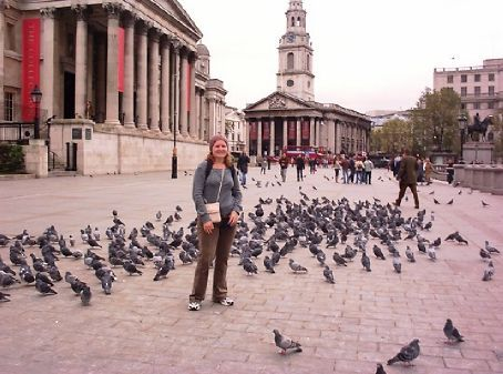 Mel surrounded by pigeons at Trafalgar Square. The National Gallery is to my left and St Martin's is in the background.