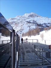 If you look carefully, the train tracks lead directly into the side of the mountain.  You go up through the center and appear on the top.  The floor of the train is actually angled steps, rather than flat.  : by melissa, Views[174]