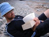 Aidan reading on the beach of a cove in the Cardigan bay.: by melissa, Views[201]