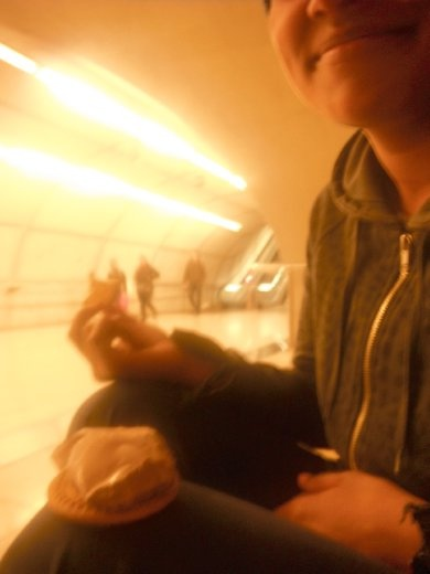 Eating chocolate and biscuits at a metro station in Bilbao, while we waited for our host