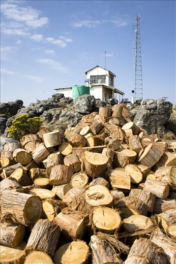 A mountain of fire wood lies stacked outside the Kaapschehoop lookout post in Mpumalanga, South Africa. Although the idyllic scenery makes the area seem like an ideal place to work, the minimum temperatures may drop as low as  - 5°c during the winter; which is why the watchmen need as much wood and warmth as possible to get them through the nippy days and nights.
