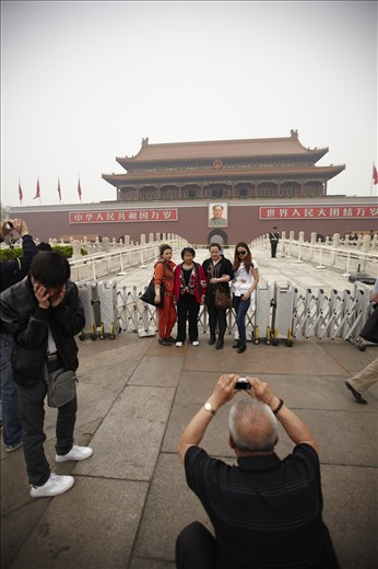 Travel boom: Chinese tourists pose in front of the Forbidden Palace, Beijing. Facilitated by the easing of government restrictions on movement, China's burgeoning middle class is driving a domestic tourism boom. It already has the world's largest domestic tourism market, with close to three billion individual visits per year. The number of Chinese tourists visiting overseas destinations is expected to increase exponentially in coming years.
