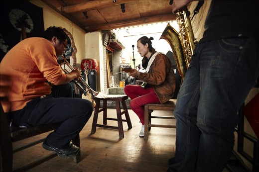 Evolving music: Fusing Mandarin lyrics with the musical sounds of the West, a Chinese rock band rehearses in one of Beijing's historic hutong houses. Facilitated by increasing access to the internet and international travel, China's middle class has unprecedented exposure to a world of cultural influences. This is creating new and unique forms of cultural output that join elements of East and West.