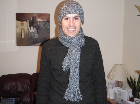 Maneesh - the proud owner of a newly knitted beanie and scarf - thanks to Em